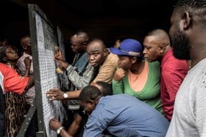 Kinshasa: Voters check the roll at the Monsignor Moke school in the district of Victoire.