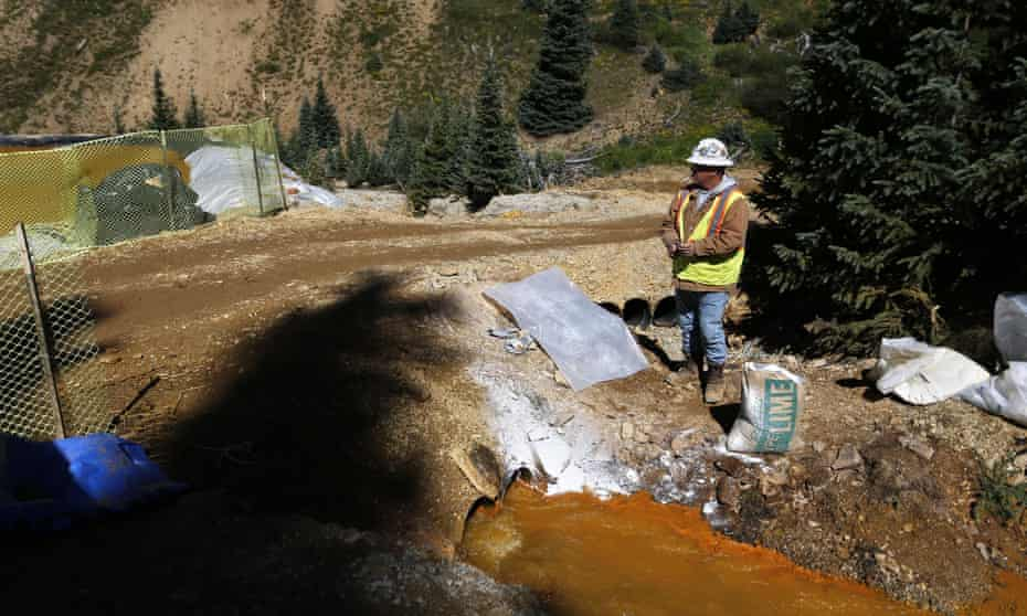 An EPA contractor keeps a bag of lime on hand to correct the PH of mine wastewater flowing into a series of sediment retention ponds, part of danger mitigation in the aftermath of the Colorado blowout.