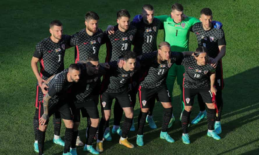 Croatia pose before their friendly against Belgium on Sunday – they did not take a knee before the game.