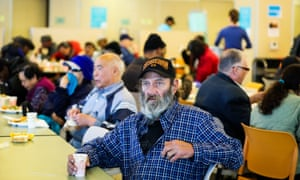 Tom Orrelle, 62, a homeless man, sits at the table of St Anthony's dining room after finishing his meal.