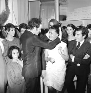Jeanne Moreau congratulates Cardin after the presentation of the autumn/winter 1964 collection
