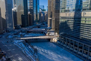 The Trump Hotel is seen along the frozen Chicago River