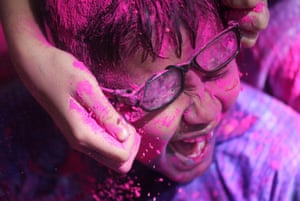 Mumbai, India. Disabled children cover each other in coloured powder during Holi celebrations