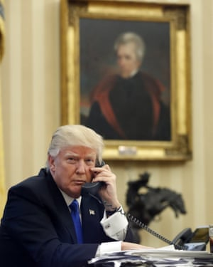 Donald Trump sits in the Oval Office beneath the portrait of President Andrew Jackson, a populist seen by some as a model for his presidency.