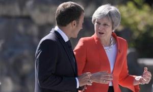 Theresa May talks to the French president, Emmanuel Macron, at the Salzburg summit last week.