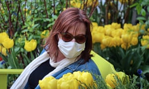 Spring flowers in New York: loss of a sense of smell is now ranked alongside a new persistent cough and a temperature as cause for self-isolation and testing.