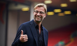 Jürgen Klopp is in confident mood as he heads on to the pitch after his official unveiling at Anfield.