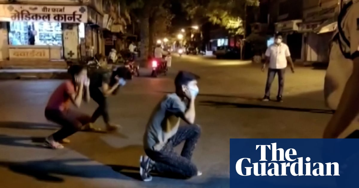 Squats, frog hops and batons: policing lockdown in India – video