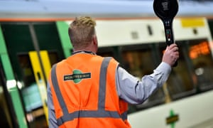 A conductor dispatches a Southern train