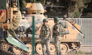 Turkish forces prepare to move against the Kurds last week after the US withdrew troops from the area.