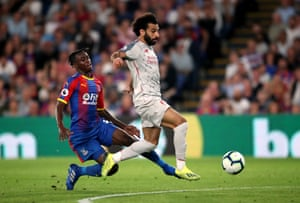 Palace's Aaron Wan-Bissaka brings down Mohamed Salah before being shown a red card.