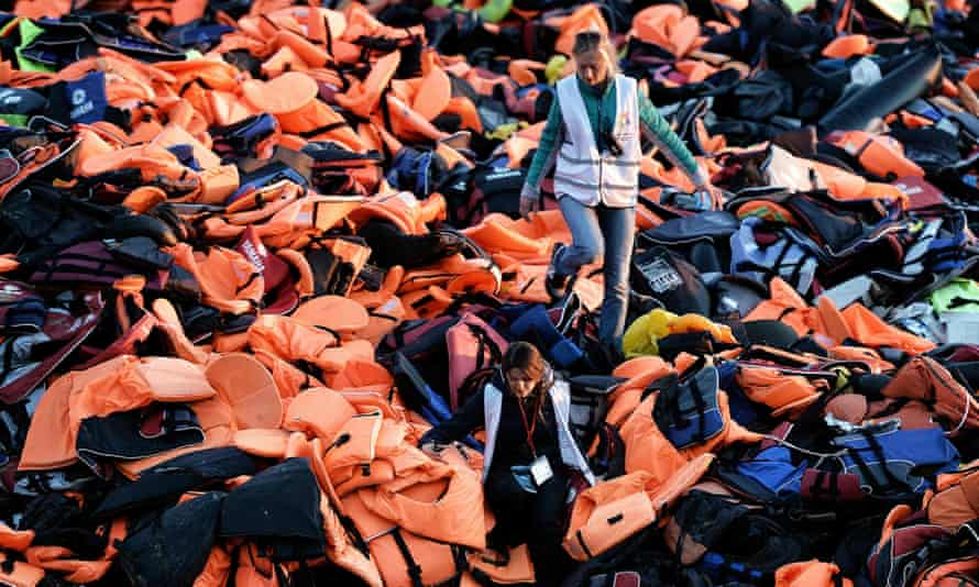 Testament to suffering … a mountain of lifejackets left behind by refugees and migrants crossing the Aegean sea from Turkey to the Greek island of Lesbos in 2015.