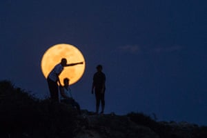People watch the supermoon rising