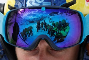 Passo Fedala, Italy: A reflection of alpine rescuers using snow probes during an avalanche training exercise, as seen on the goggles of a fellow worker. Twice a month, members of the Italian Alpine Rescue Service, many of whom are volunteers, gather for these sessions 2,000 metres up the Dolomites mountain range