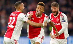 Ajax's David Neres (centre) celebrates after getting the home side back on level terms.