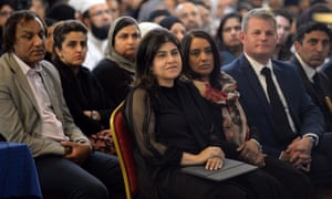 Baroness Sayeeda Warsi joins people at a vigil in the Indian Muslim Welfare Society's Al-Hikmah Centre in Batley.