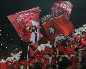 Olympiacos fans attempt to lift their side against Arsenal but the Greek team lost 3-0.