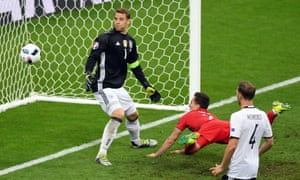 Poland's Arkadiusz Milik somehow sends his stooping header wide from three yards out to allow Germany to escape with a draw.