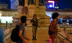A Turkish military stands guard in the Taksim Square in Istanbul.