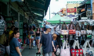 Tourists walk past street vendors on Khaosan Road.