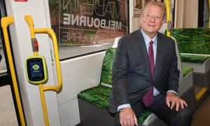Al Gore rides a tram the tram in Melbourne in July.