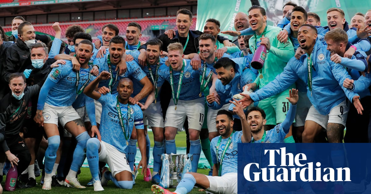 Manchester City win fourth Carabao Cup in a row as Laporte sinks Spurs