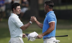 Rory McIlroy (left) shakes hands with the victorious Brooks Koepka after the WGC-FedEx St Jude in Memphis.