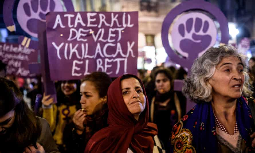 Protesters hold a banner reading 'Women resist male domination' as they march in Istanbul in 2016.