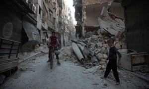 Syrians walk through the rubble following an airstrike on the regime-controlled neighbourhood of Karm al-Jabal in Aleppo.