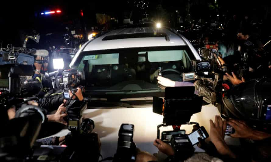 Reporters gather around a car, part of a convoy believed of transporting Emilio Lozoya after his extradition from Spain, in Mexico City last month.