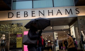 Shoppers walk past the struggling Debenhams department store on Oxford Street in London.