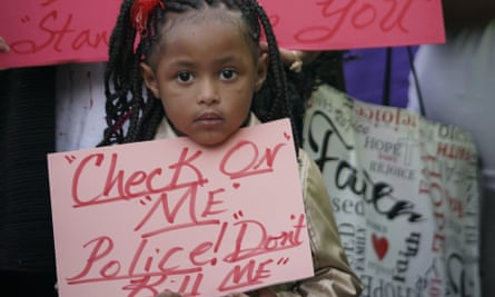 """Trinity Ford, 4, joins the crowd gathered during a community vigil for Atatiana Jefferson on Sunday, Oct. 13, 2019, in Fort Worth, Texas. A white police officer who killed the black woman inside her Texas home while responding to a neighbor's call about an open front door """"didn't have time to perceive a threat"""" before he opened fire, an attorney for Jefferson's family said. (Smiley N. Pool/The Dallas Morning News via AP)"""