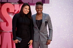 British boxer and Olympic gold medalist Nicola Adams, right, poses on the pink carpet