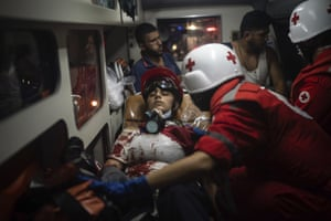 An injured demonstrator lies in an ambulance after clashes with police during an anti-government protest in Beirut.