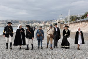 World War One Historical Association members walk on the beach of the Promenade des Anglais