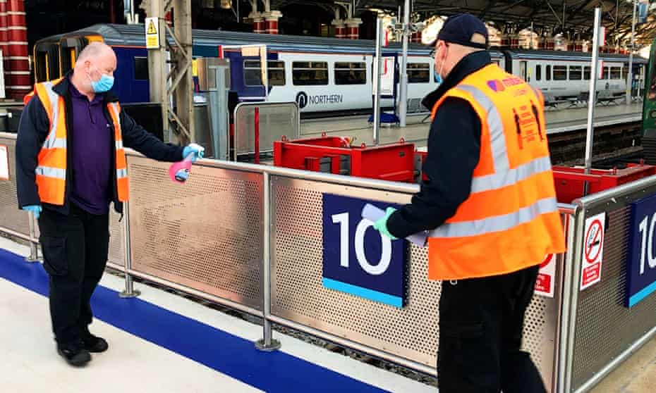 Staff cleaning the handrails at Liverpool Lime Street station, where no traces of coronavirus were found in January and June tests