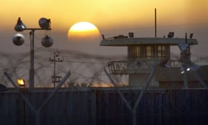 The sun rises on the Abu Ghraib prison on the outskirts of Baghdad, Iraq Tuesday, June 22, 2004. On Monday a judge declared the notorious prison a crime scene and forbade its destruction, as had been previously offered by President Bush.(AP Photo/John Moore)