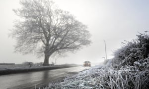 In southern England, on 6 December 2010, rime coats the roadway banks near Kingscote, Gloucestershire.