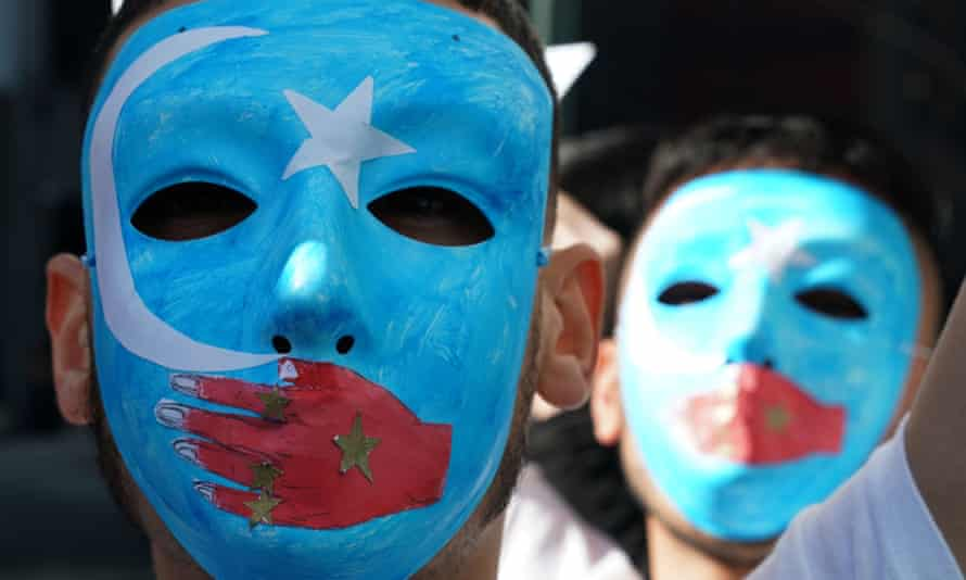 People protest at a pro-Uighur rally outside UN headquarters in New York.