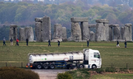 Traffic passes Stonehenge on the A303.