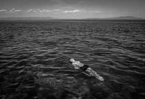 Greece, June 2017 Teenager Mortaza swims in the Aegean Sea