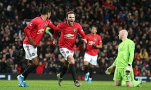 Juan Mata of Manchester United celebrates scoring the winner.