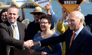 David Macdonald (left) shakes hands with the Liberal Democrat leader, Vince Cable. in South Queensferry