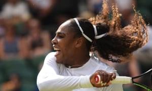 Serena Williams plays a shot during her 6-2, 6-2 win against Evgeniya Rodina at Wimbledon