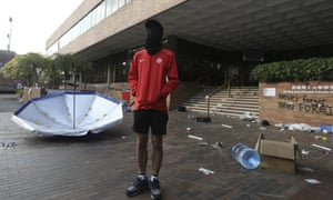 A protester stands inside the campus of Polytechnic University in Hong Kong