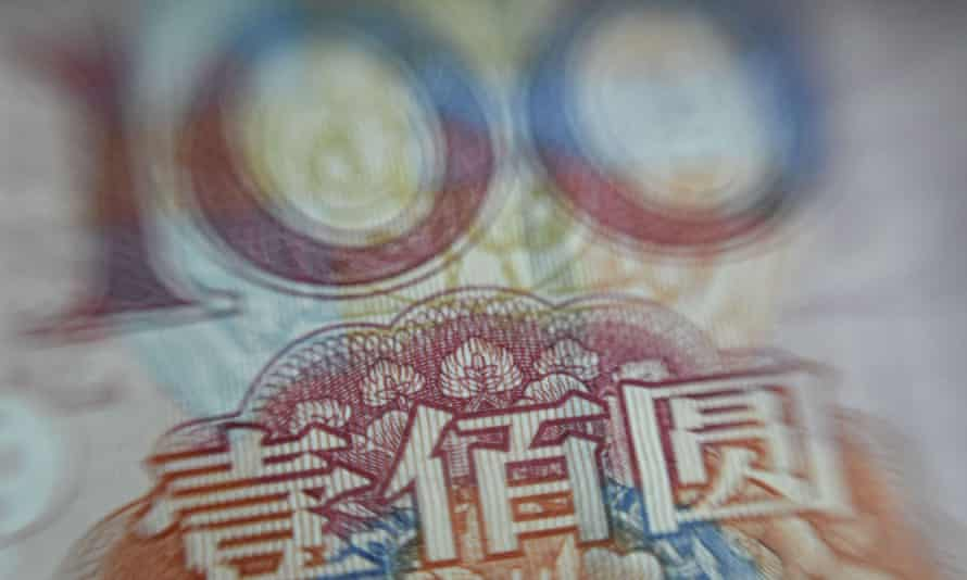 A Chinese 100-yuan note. Authorities have arrested 21 people involved in the Ezubao peer to peer company which they allege is an online scam which has ripped off nearly million investors.