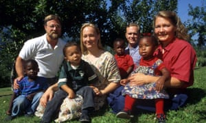 Rachel Dolezal in 1996 with her parents, Lawrence (left) and Ruthanne (right), her brother Joshua, and four young children the family had adopted
