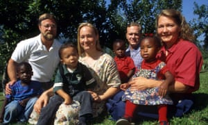 Rachel Dolezal in 1996 with her parents, Larry and Ruthanne, her brother Joshua, and four children the family had recently adopted.