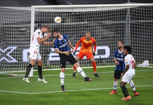 Sevilla's Luuk de Jong guides a header across the face of goal past Samir Handanovic.