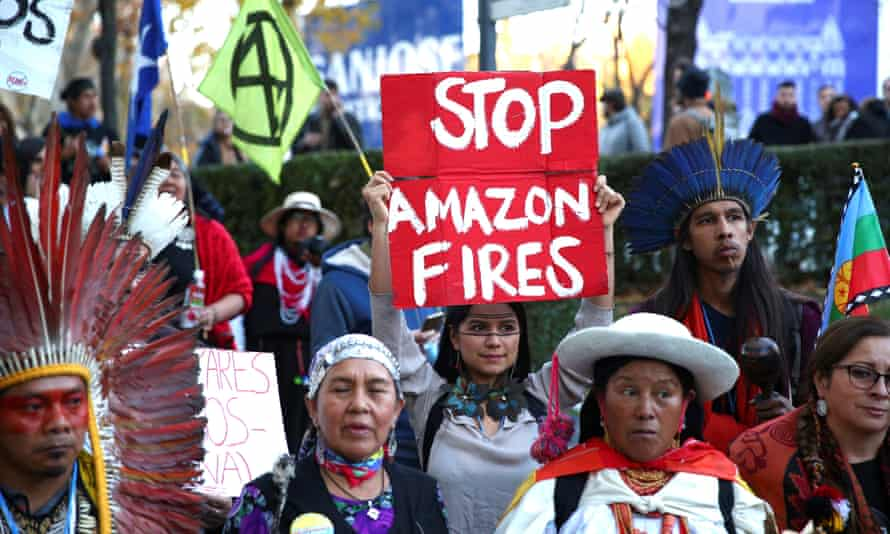 South American indigenous people attend a protest in Madrid, Spain, over the climate
